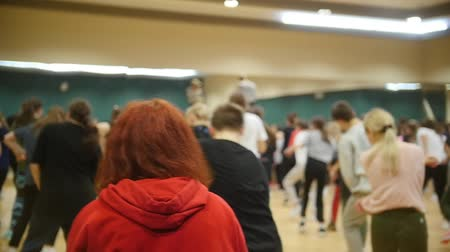mob : Active group dances. Girl with red hair