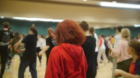 mob : Open group dance lesson. Girl with red hair