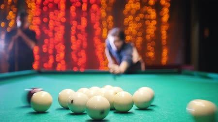 tágo : Billiards club. A man aiming and hitting the ball. The game starts