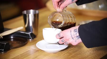 americano : Barista making coffee. Barista pouring an americano in the cup