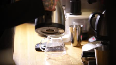 another : Barista making coffee americano in alternative method