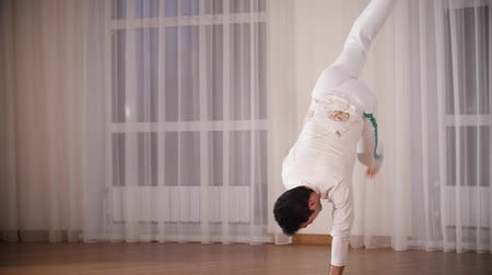 acrobats : Martial arts. Capoeira. A professional acrobatic man performs a capoeira movements Stock Footage