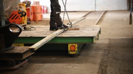 metallurgical : Industrial concept. An industrial lifting crane holding a detail