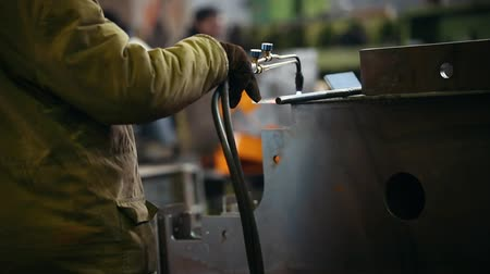 metallurgical plant : Industrial concept. A man working with a welding machine. Heating up the metal detail