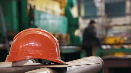 welding helmet : Construction plant. People working on a plant. A helmet on a foreground Stock Footage