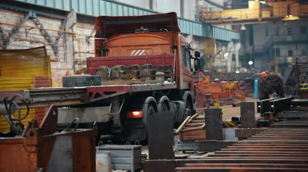 metallurgical : Industrial concept. Construction plant. A truck waiting for the shipment. A crane moves towards the truck