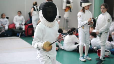 saber : 27 MARCH 2019. KAZAN, RUSSIA: Little girl fencer fighting on a fencing tournament