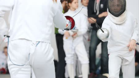 saber : 27 MARCH 2019. KAZAN, RUSSIA: Little girls in white clothes fighting on a fencing tournament