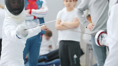 saber : 27 MARCH 2019. KAZAN, RUSSIA: Little girls fencers in protective clothes fighting on a fencing tournament