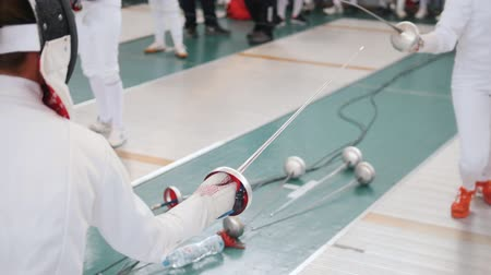 saber : 27 MARCH 2019. KAZAN, RUSSIA: Teenage girls fencers in protective clothes training their fighting