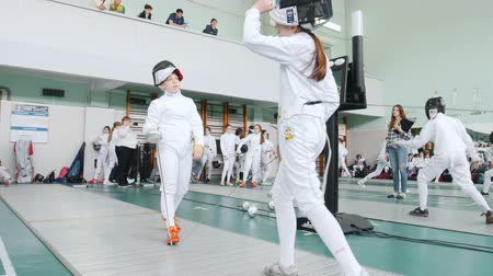 saber : 27 MARCH 2019. KAZAN, RUSSIA: Teenagers in protective clothes fighting on a fencing tournament in the hall