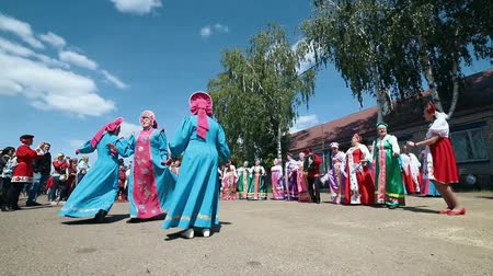 zsebkendő : RUSSIA, Nikolskoe village, Republic of Tatarstan 25-05-2019: A mature women in traditional russian clothes dancing in a village by accordion music
