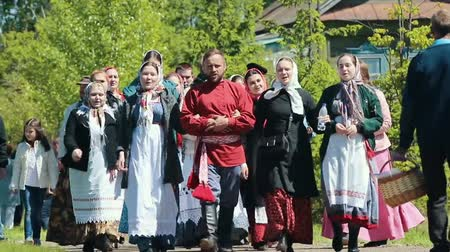 zsebkendő : RUSSIA, Nikolskoe village, Republic of Tatarstan 25-05-2019: A group of people walking on the road in a village and singing a song