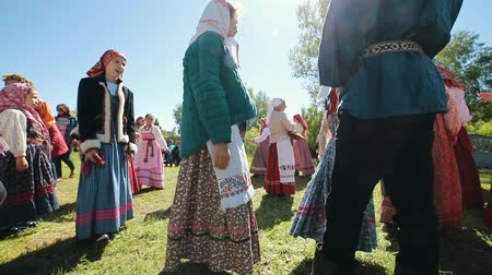 zsebkendő : RUSSIA, Nikolskoe village, Republic of Tatarstan 25-05-2019: People in a village walking in a circle by a music. Playing traditional game