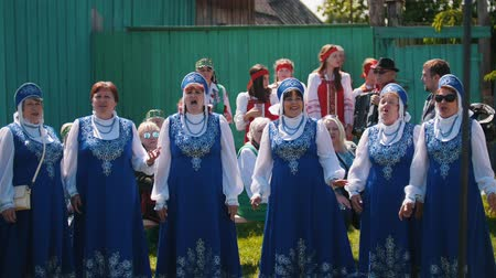 choral : Tatarstan, Laishevo 25-05-2019: Women perform choral singing and the man plays the accordion
