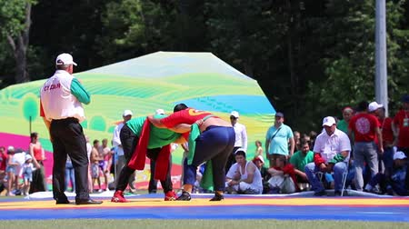 folklór : REPUBLIC OF TATARSTAN, RUSSIA: 04.07.2019 - Two men fight in the open air during Sabantui