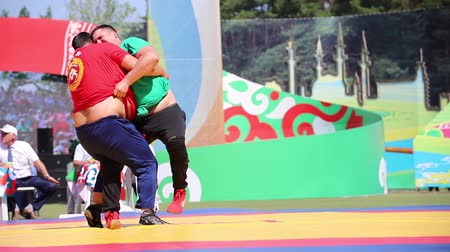 pianta grassa : REPUBLIC OF TATARSTAN, RUSSIA: 04.07.2019 - Two fat men fight on sabantui - One of them on red clohtes wins the other