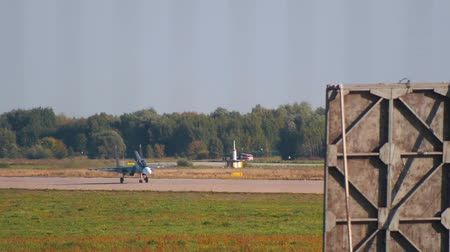 freedom fighter : 29 AUGUST 2019 MOSCOW, RUSSIA: reactive dark fighter plane is gaining speed on the runway