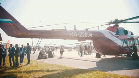 freedom fighter : 30 AUGUST 2019 MOSCOW, RUSSIA: an outdoors airplane exposition - RA-22894 Mi-8ATM helicopter standing on the area Stock Footage