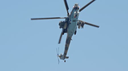 sierpien : 29 AUGUST 2019 MOSCOW, RUSSIA: A light green camouflage military helicopter with small red star flying in the clear sky