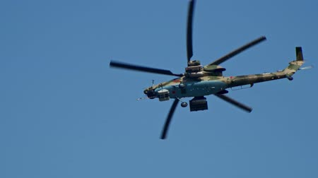 kanatlar : 29 AUGUST 2019 MOSCOW, RUSSIA: A light green camouflage military helicopter with small red stars on the corpus flying in the clear sky