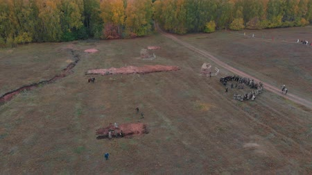 historical reconstruction : RUSSIA, REPUBLIC OF TATARSTAN 30-09-2019: A reconstruction of military operations in Russia in 1917 - an area surrounded by people