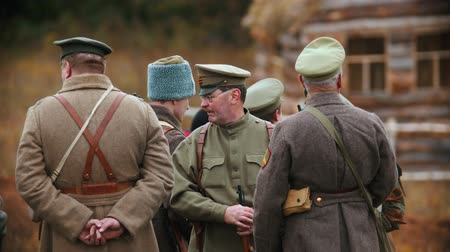 rytíř : RUSSIA, REPUBLIC OF TATARSTAN 30-09-2019: A reconstruction of military operations in Russia in 1917 - mature men soldiers standing on the field and talking