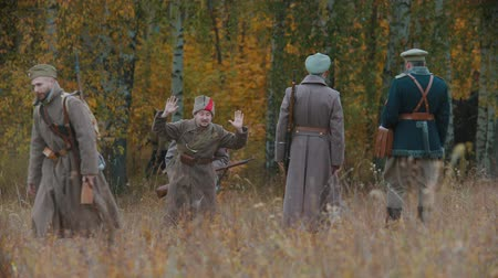 zbroja : RUSSIA, KAZAN 30-09-2019: A reconstruction of military operations in Russia in 1917 - Performing hostilities - Soldiers walking on the field - One of them walking with his hands up Wideo