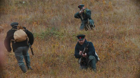 historical reconstruction : RUSSIA, REPUBLIC OF TATARSTAN 30-09-2019: A reconstruction of military operations in Russia in 1917 - Performing hostilities on the busy battlefield - Running away Stock Footage