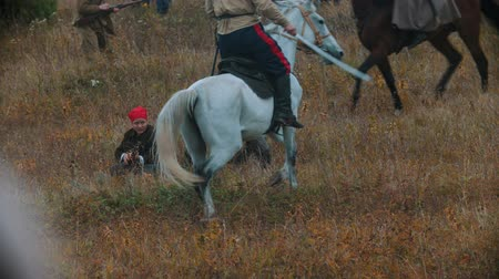 soldiers : RUSSIA, REPUBLIC OF TATARSTAN 30-09-2019: A reconstruction of military operations in Russia in 1917 - Performing hostilities on the busy battlefield - Soldiers on the horseback passing by the others