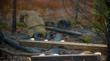 combate : Dead soldier lying on the iron wire - piece of log on a foreground