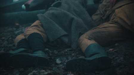 infantaria : An injured soldiers lying on the ground Stock Footage