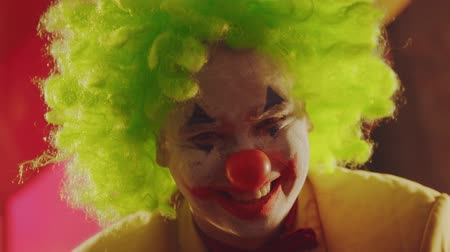 uğursuz : A crazy smiling clown with creepy emotions Stok Video