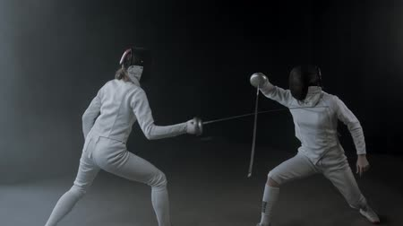 armas : Fencing training in the studio - two women having a duel