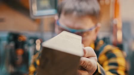 lumber : Carpentry industry - working in the workshop - a man woodworker inspect wooden detail for the imperfections Stock Footage