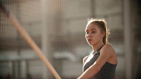 feminity : pole vaulting - beautiful athlete is configuring to jump and starting to run Stock Footage