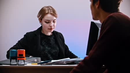 descarga : An office working - a woman pulls out a nameplate with YOURE FIRED sign - a man shrugs and walks away