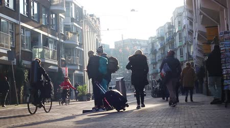 morning : 23-11-2019 NETHERLANDS, AMSTERDAM: busy people walking on one of the streets of Amsterdam