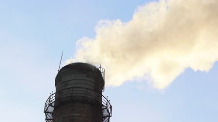 emissions : Industrial concept - smoke coming out of a manufacturing pipe - atmospheric pollution - winter