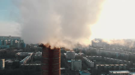 ısıtma : Industrial concept - smoke coming out of a manufacturing pipe - atmospheric pollution of an air in the big city Stok Video