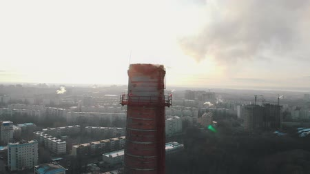 energetyka : Air pollution problem - a big industrial pipe pollutes the air in the city - daylight
