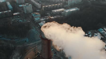 ısıtma : Air pollution problem - a smoke coming out from industrial pipe from the manufacturing plant pollutes the air in the city Stok Video