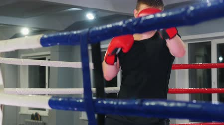 stanovena : Box training in the gym - a man performing a shadow boxing