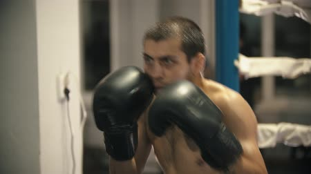 сила : Box training - a man training - shadow fighting