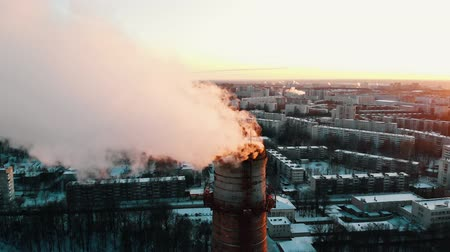 energetyka : Idustrial - deep smoke coming out of a manufacturing pipe - atmospheric pollution of the city