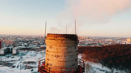 energetyka : pollution problem - a smoke coming out from pipe from the industrial plant pollutes the air