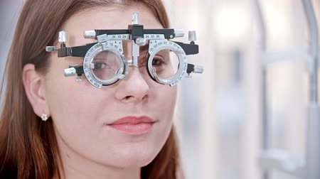 slit : ophthalmologist - woman is sitting in special glasses and smiling