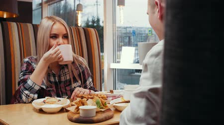 cutlery : A cute couple having lunch in cafe Stock Footage