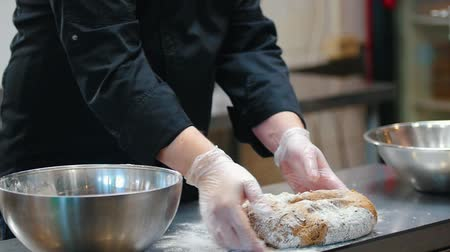 sponka : KITCHEN - the cook is kneading the dough on the countertop