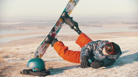 prosthesis : 14-12-19 RUSSIA, KAZAN: Snowboarding - A man with prosthetic leg trying to stand up